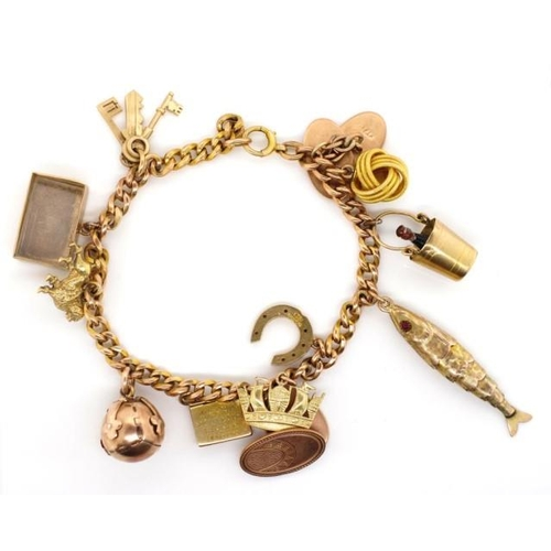 45 - Gold charm bracelet with Masonic cross orb and naval crown charm with touch marks to chain and mixed...