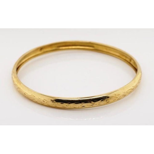 49 - 9ct yellow gold bangle engraved with floral decorations marked 9ct WD. Approx  weight 6.98 grams, in...