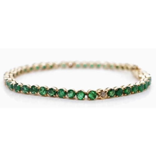 51 - 10ct yellow gold, emerald and diamond bracelet of single line tennis design. Set with approx 42x  0....