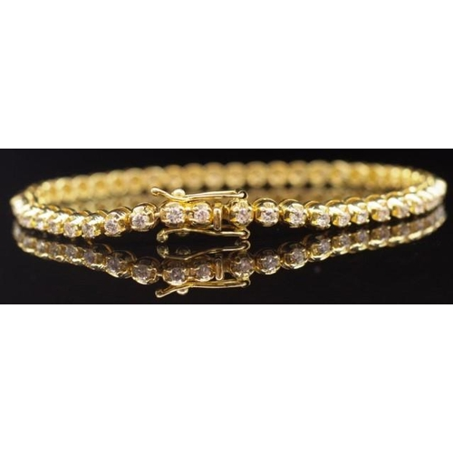 52 - 18ct yellow gold and diamond tennis bracelet marked 750 Italy to clasp approx 1.5ct weight of round ...