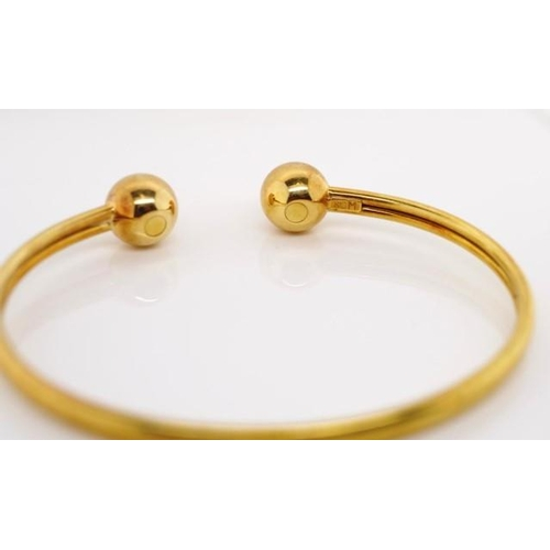53 - 18ct yellow gold torque bangle marked K18M approx weight 11.8 grams, inside width 62mm...