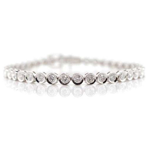 55 - 4.23ct Diamond and 18ct gold tennis bracelet with bezel settings marked 750 approx 12.77 grams gold ...