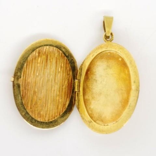 74 - 14ct yellow gold locket with a textured front and plain back. marked 585 and makers to jump ring and...