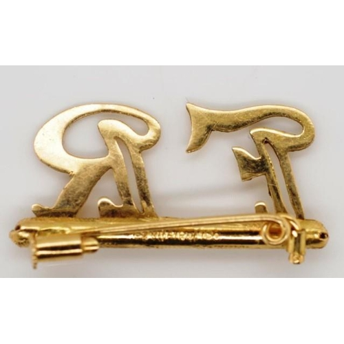 75 - 18ct yellow gold brooch initial for FR marked 750 approx weight 2.22 grams...