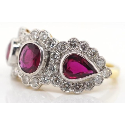 81 - 18ct gold ruby & diamond ring. Edwardian style ruby trilogy halo ring. With a yellow gold tapered sh...