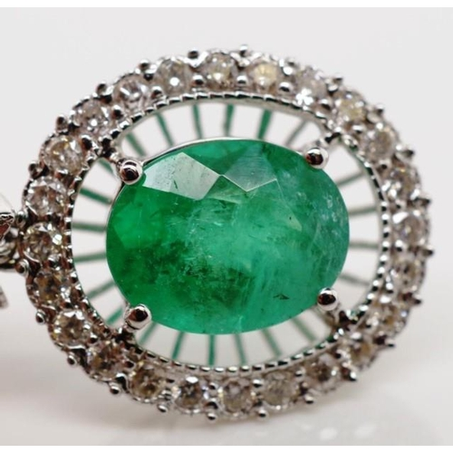96 - Emerald, diamond and 18ct white gold earrings in an Edwardian style. With mille grain borders and cl...