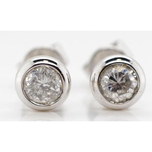99 - Diamond and 18ct white gold stud earrings Bezel set  Marked 750 Approx round brilliant cut diamonds ...