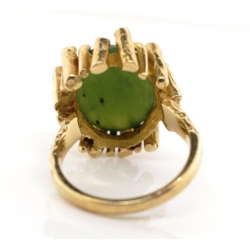 18 - Nephrite jade set 9ct yellow gold ring marked 9ct. Approx 9.3 grams, ring size N-O...