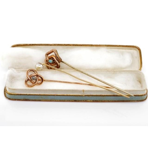 22 - Two antique gold and gemstone stick pins set with a diamond, a pearl as well as a gilt metal piece. ...