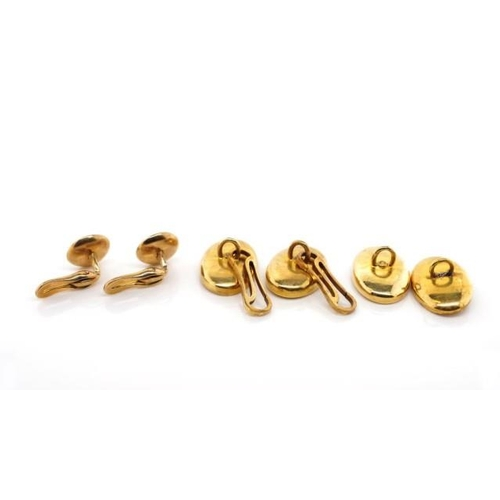 24 - Gold and mother of pearl cufflinks and dress studs. Approx total weight 8 grams, gold tests as 14ct...