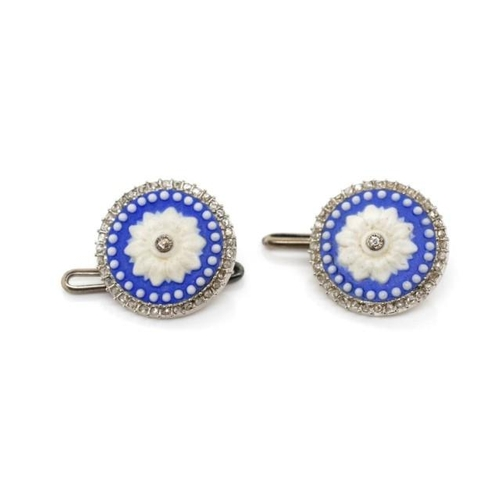 26 - Antique diamond set shirt studs with a white floral swag set on a blue background set with old mine ...