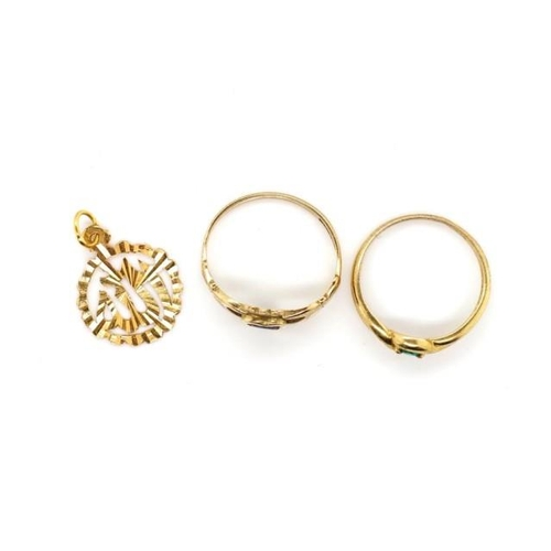 27 - Two 9ct gold rings and a gold charm both rings marked 375 and charm has a partial mark. Approx total...