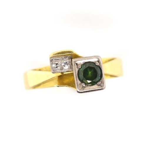 28 - 18ct yellow gold diamond and green stone ring marked 18c. Green stone tests as spinel. Approx weight...