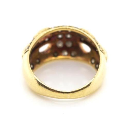 30 - Diamond set 18ct yellow gold buckle ring marked 18kt approx 18x round brilliant cut grain set diamon...