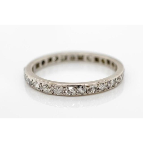 14 - Diamond and platinum eternity ring unmarked. Approx weight 2.4 grams, ring size N. Tests as Platinum...