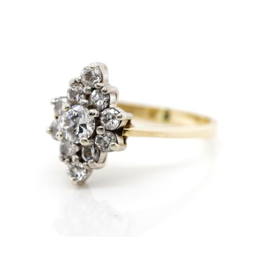 16 - Diamond cluster and 18ct yellow gold ring in a navette setting. Marked 18ct. Approx center round bri...