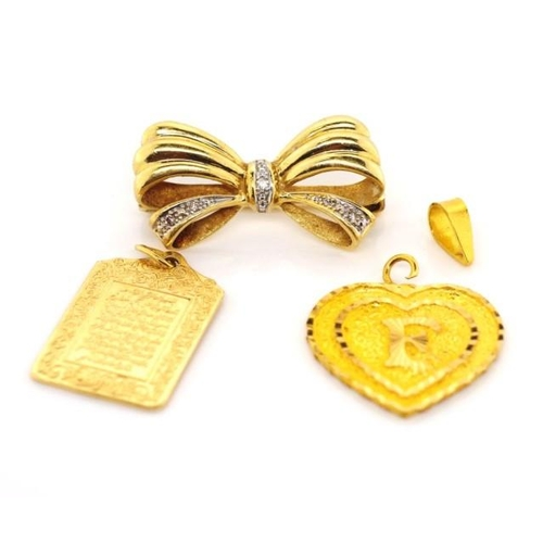 37 - Diamond bow brooch and two gold charms approx total weight 8.3 grams. The heart tests as 21ct and we...