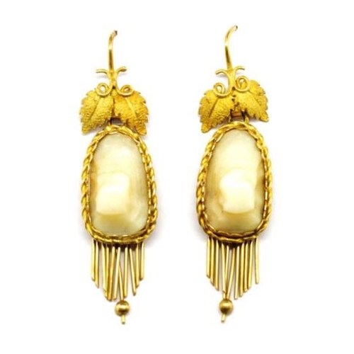 40 - Victorian 18ct gold and teeth earrings with applied leaf & vine decoration and Shepherd hook fitting...