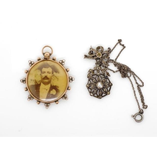 41 - Edwardian gold pendant and silver pendant the open locket pendant is marked Birmingham 1905 9ct. The...