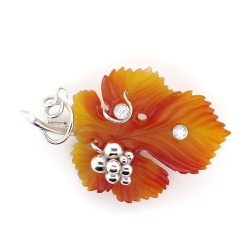 43 - 18ct white gold, diamond and carnelian brooch of leaf vine leaf and grape form. Set with diamonds, m...