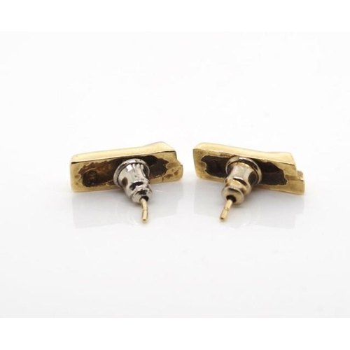 44 - Two tone gold stud earrings unmarked. Approx weight 2.99, ex base metal backs. Tests as 14ct...