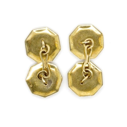 45 - Early 20th C. yellow gold cufflinks with octagonal engine turned shields and acanthus borders marked...