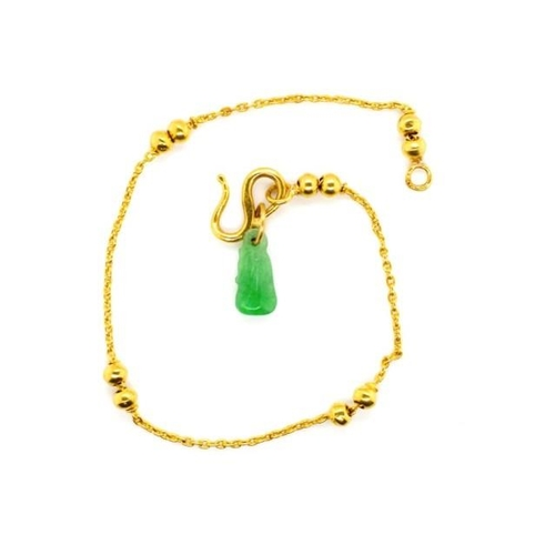 46 - Yellow gold bracelet and jade charm marked 24k to snake hook clasp. Approx weight 2.8 grams ex charm...