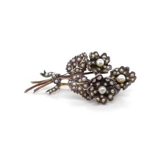 50 - Antique gold backed and pearl set flower brooch unmarked. Approx weight 9.6 grams. Some old repairs ...