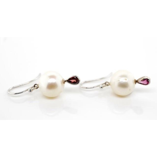 52 - Pearl, tourmaline and 9ct white gold earrings marked 375 to shepherd hooks. Approx 12mm white cultur...