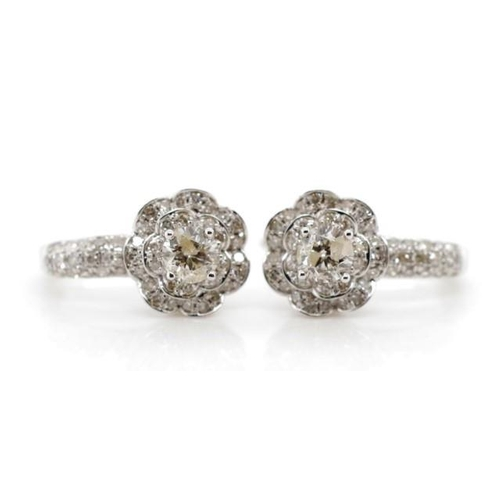 54 - Diamond and 14ct white gold earrings marked 585 to lever backs. Approx weight 3.7 grams....