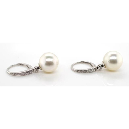 55 - South sea pearl, diamond and 18ct gold earrings marked 750 18k. With lever back hooks approx 2x 11mm...