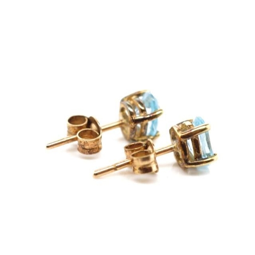 56 - Topaz and 9ct yellow gold stud earrings marked 375...