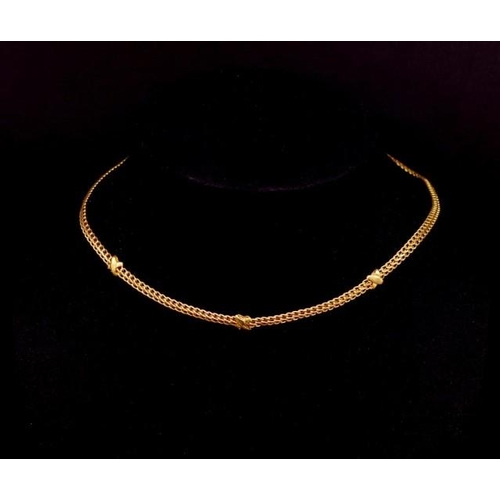 57 - 10ct yellow gold necklace double row curb chain with cross decorations. Marked 10k Italy. Approx wei...