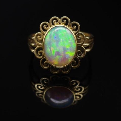 58 - 14ct yellow gold and opal ring marked 585 vs. Approx weight 5.88 grams, ring size Q. With valuation...