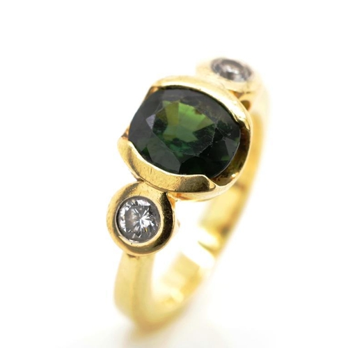 18 - Green sapphire, diamond and 18ct yellow gold ring rubbed 750 marks. Approx weight 7 grams, ring size...