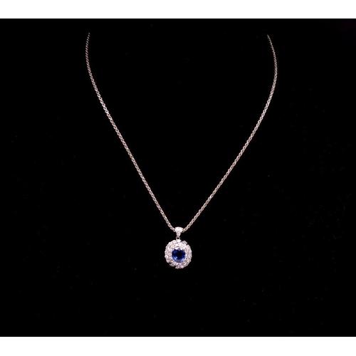 21 - 1.65ct Sapphire and diamond set 18ct gold pendant ,with a diamond set double white gold halo and bai...