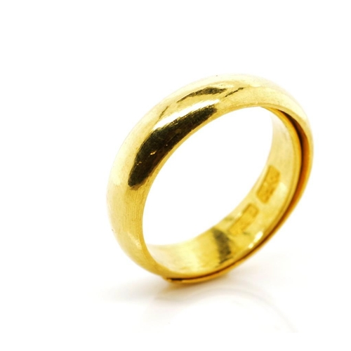Yellow gold wedding band with Oriental marks to inside  Of 5mm D end