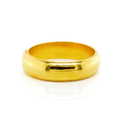 25 - Yellow gold wedding band with Oriental marks to inside. Of 5mm D end shape, approx weight 9.63 grams...