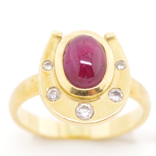 30 - Ruby, diamond and 18ct yellow gold ring of horse shoe design set with a ruby 7.5mm x 6.8mm cabochon,...