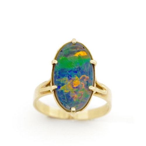 47 - Opal triplet and 18ct yellow gold ring marked 750. Approx weight 3.65 grams, ring size N...