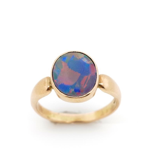 49 - Opal doublet and 9ct rose gold ring marked 9ct. Approx weight 2.49 grams, ring size M...