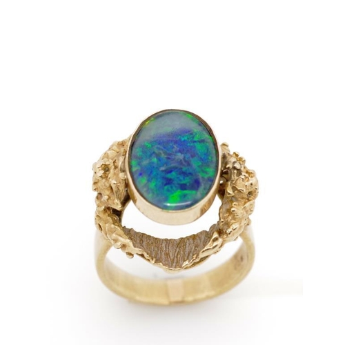 50 - Opal triplet and 9ct yellow gold Modernist ring marked 9ct. Approx weight 7 grams, ring size N. Shwi...