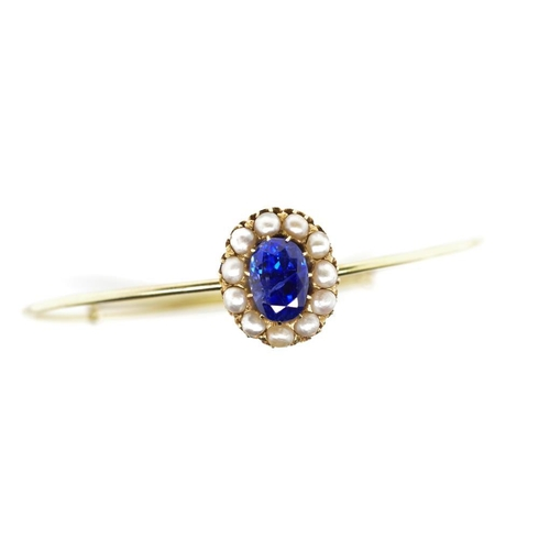 57 - 3.00ct Blue sapphire, seed pearl set gold bangle , the oval cut blue sapphire of Burmese type measur...