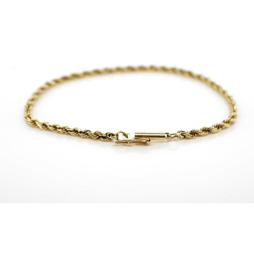 11 - Yellow gold rope chain bracelet with a barrel clasp and safety catch. Approx chain size 1.6mm, weigh...
