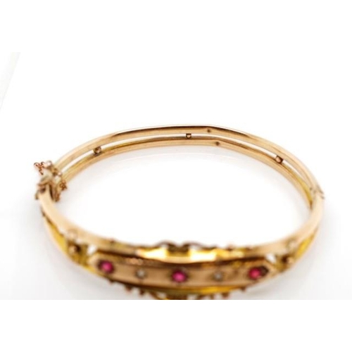 13 - Edwardian 9ct rose gold bangle set with red gemstones and rough cut diamonds. Marked Birmingham 1905...