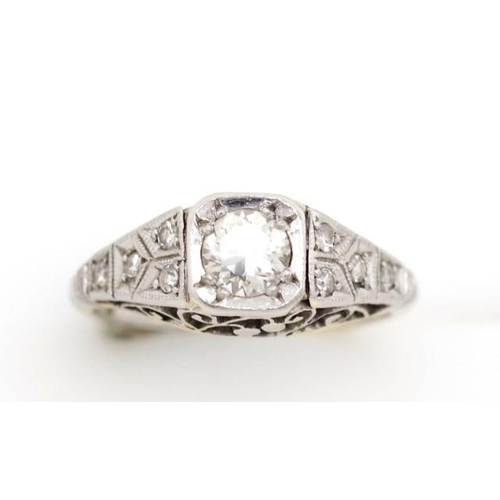 15 - 0.35ct diamond and 18ct white gold Art deco ring with fine filigree scroll floral work and mille gra...