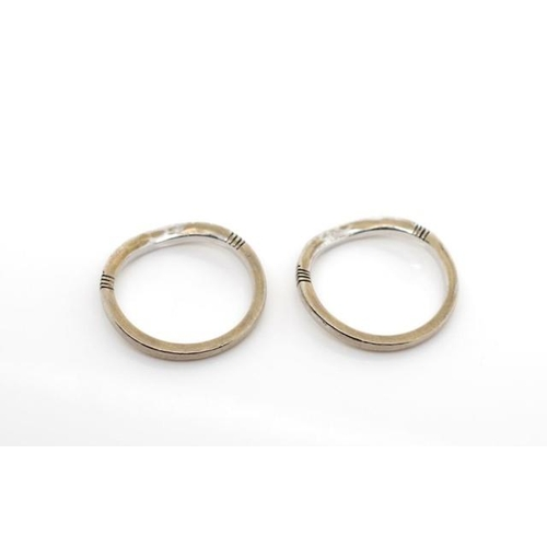 16 - Two diamond set 18ct white gold curved rings unmarked. Approx weight 4.4 grams, 16x round brilliant ...