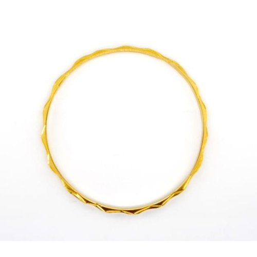 2 - Yellow gold bangle with flat and pyramid type decorated wire. Rubbed character marks. Approx inside ...