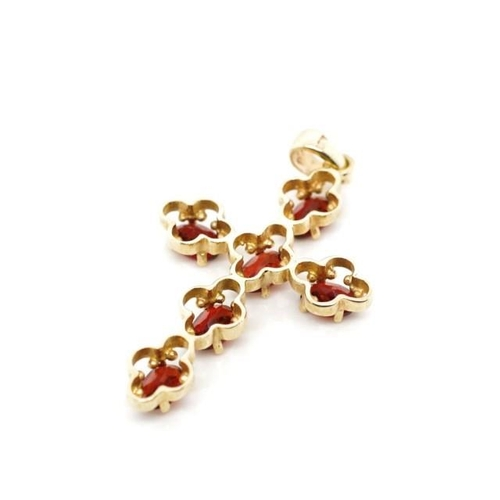 26 - Garnet and 9ct yellow gold cross rubbed 9ct marks to bail. Approx weight 3.4 grams, length 36mm...