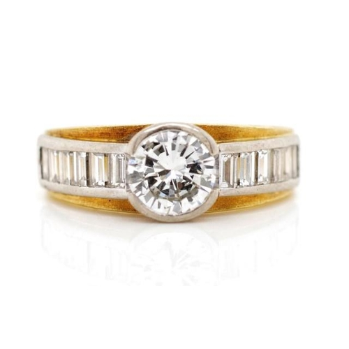 29 - 0.90ct Diamond and 18ct two tone gold ring marked 750. With approx 1x semi bezel set round brilliant...